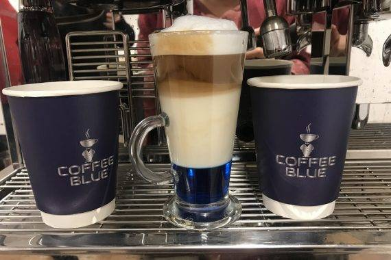 Barista made coffees at coffee machine